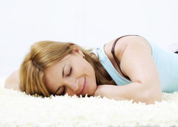 Woman sleeping on carpet floor